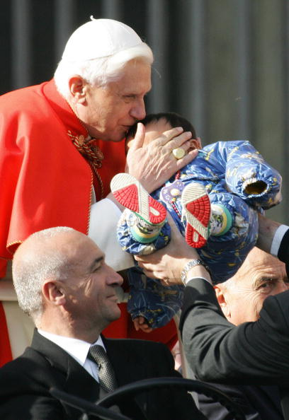 Pope Benedict XVI kisses a baby on St-Pe
