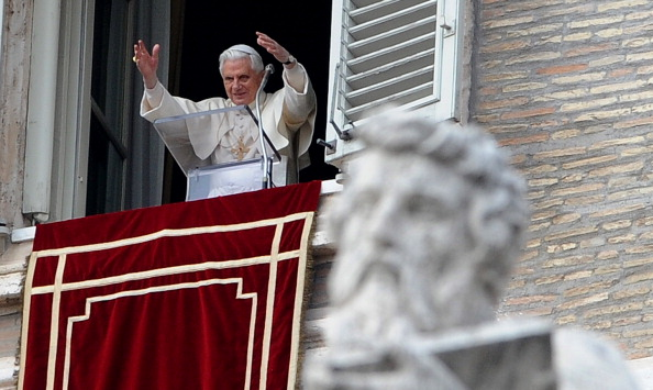 Pope Benedict XVI speaks from the window