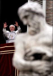 Pope Benedict XVI greets pilgrims from the window of his studio overlooking St.Peter's square during the Angelus in Rome, Vatican City on January 21, 2007.