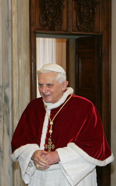 Pope Benedict XVI leaves the library of