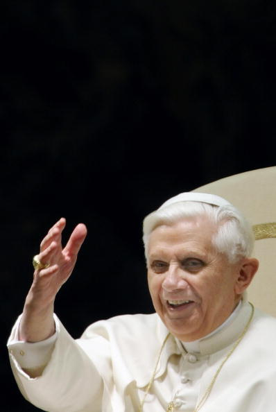 Pope Benedict XVI salutes the believers
