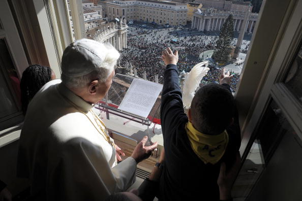 Pope Benedict XVI sets free a dove from
