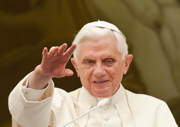 Pope Benedict XVI waves to pilgrims gath