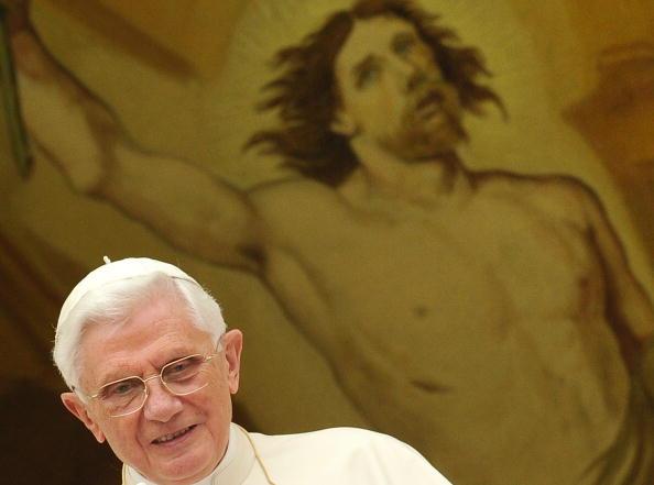 Pope Benedict XVI looks at pilgrims gath