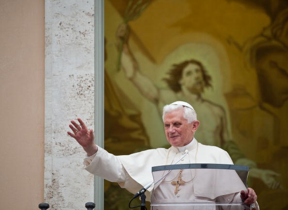 Pope Benedict XVI waves at pilgrims gath