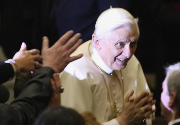 Pope Benedict XVI is greeted by  believe