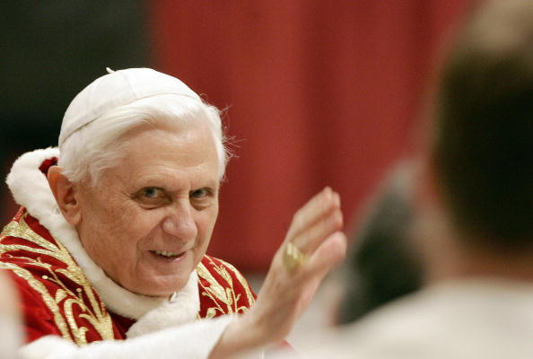 Pope Benedict XVI salutes as he arrives