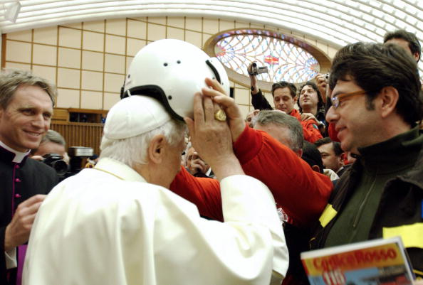 Pope Benedict XVI tries a firefighter's