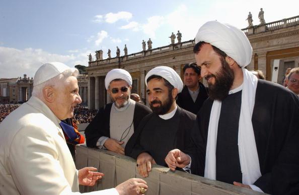 Pope Benedict XVI talks with unidentifie