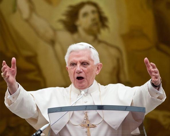 Pope Benedict XVI gestures at pilgrims g