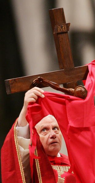 Pope Benedict XVI carries the cross as h