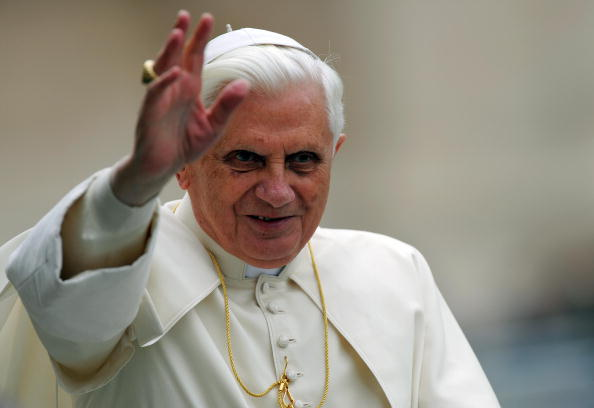 Pope Benedict XVI waves to faithful as h