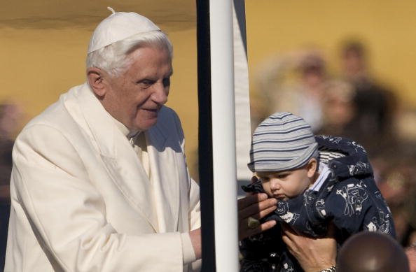 Pope Benedict XVI blesses a child during