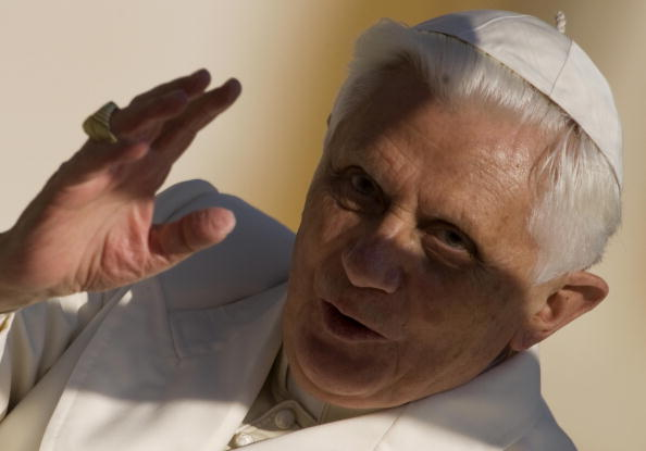 Pope Benedict XVI greets faithful upon h