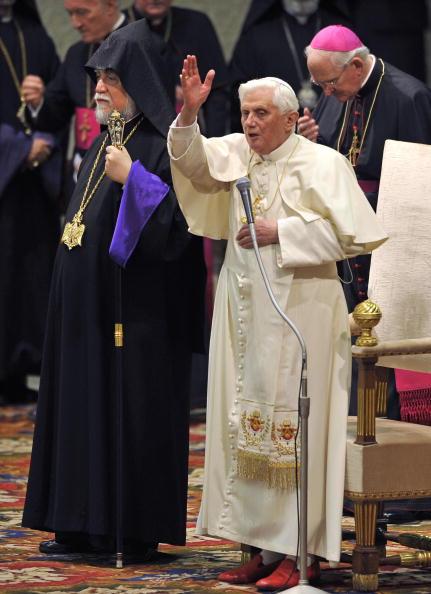 Pope Benedict XVI (C) blesses faithful w