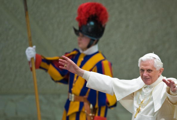 Pope Benedict XVI waves to faithful at t