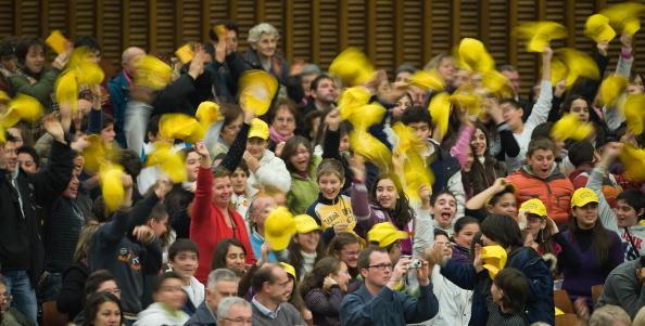 Pilgrims wave to Pope Benedict XVI durin