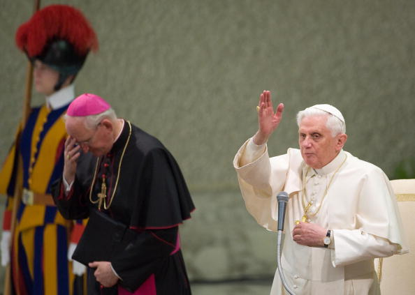 Pope Benedict XVI (R) blesses faithful d