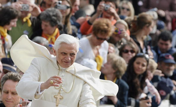 Pope Benedict XVI salutes the crowd as h