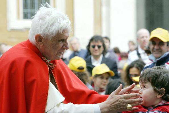 Pope Benedict XVI greets a boy at the en