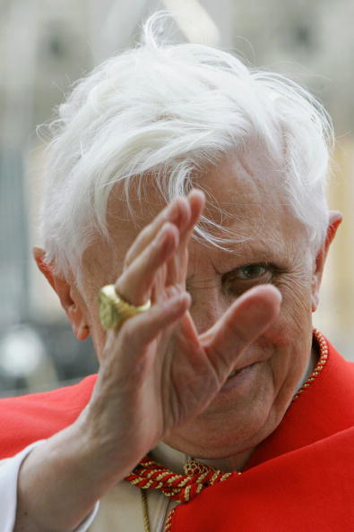 Pope Benedict XVI salutes at the end of