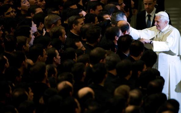 Pope Benedict XVI (R) greets seminarians