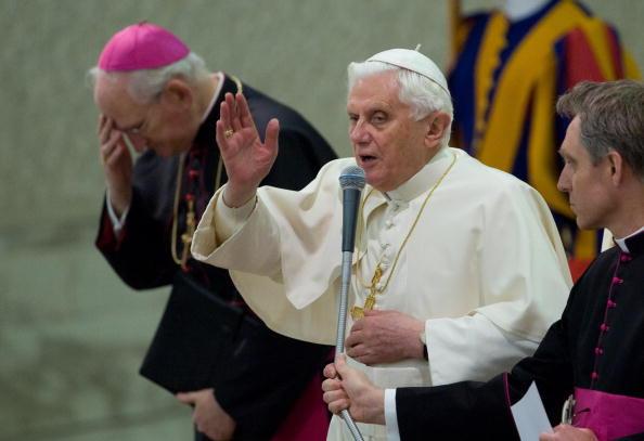 Pope Benedict XVI (C) blesses faithful d