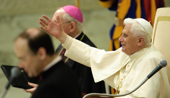 Pope Benedict XVI waves to faithful gath