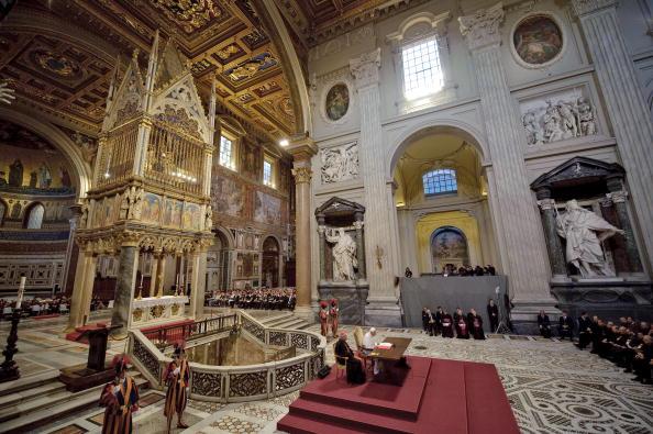 Pope Benedict XVI (C)  reads his message