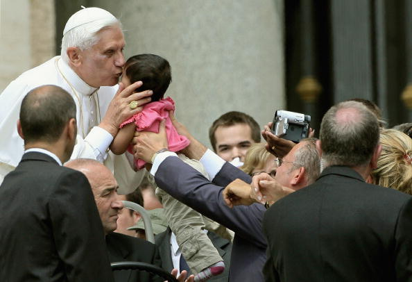 Pope Benedict XVI kisses a baby in St. P