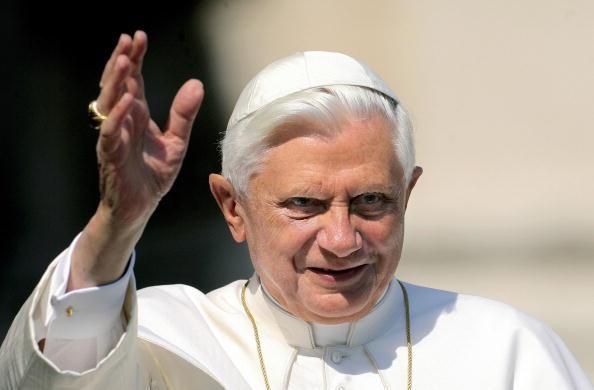 Pope Benedict XVI waves to pilgrims gath